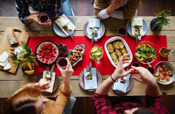 Group of friends eating festive dinner